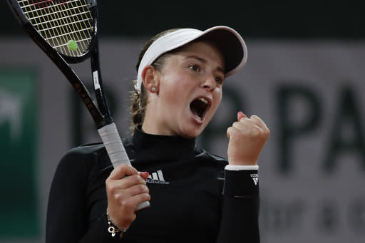 Latvia's Jelena Ostapenko celebrates winning her second round match of the French Open tennis tournament against Karolina Pliskova of the Czech Republic in two sets, 6-4, 6-2, at the Roland Garros stadium in Paris, France, Thursday, Oct. 1, 2020. (AP Photo/Alessandra Tarantino)