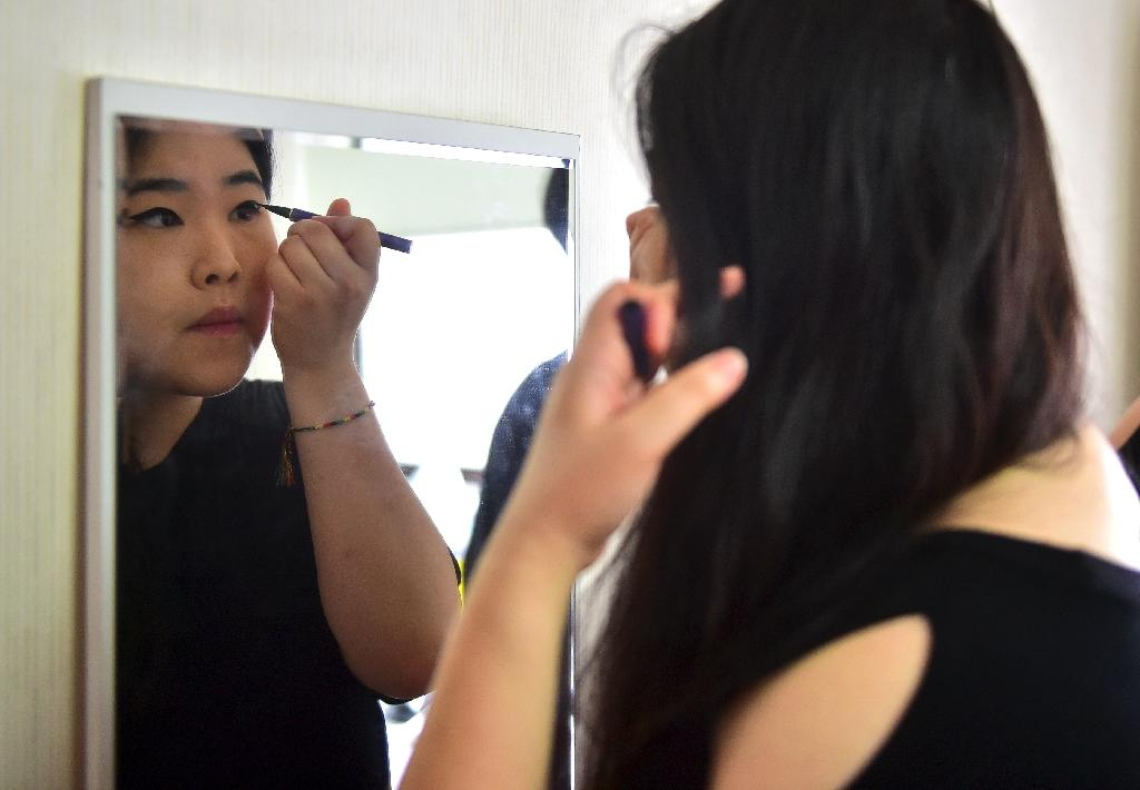 Vivian Geeyang Kim, who is a US size 10, runs an online clothing shop and publishes a fashion magazine specifically for plus-size women in South Korea (AFP Photo/Jung Yeon-Je)