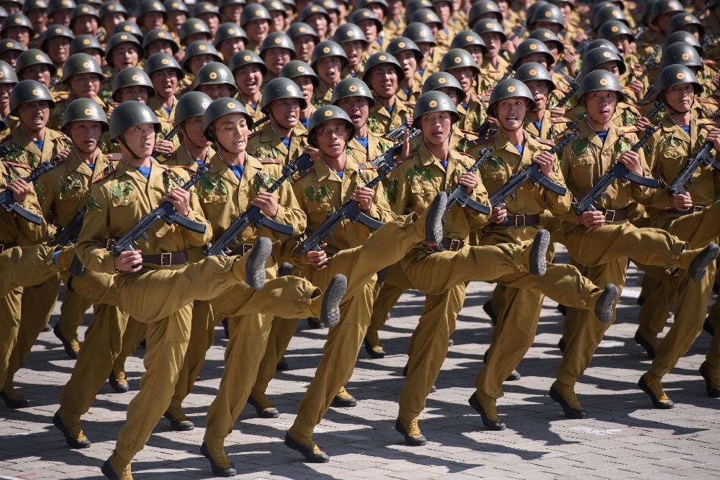 North Korean troops march in Pyongyang on September 9, 2018 during a huge military parade marking the 70th anniversary of the country's creation