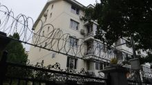 Chinese police guard late dissident's home, empty or not