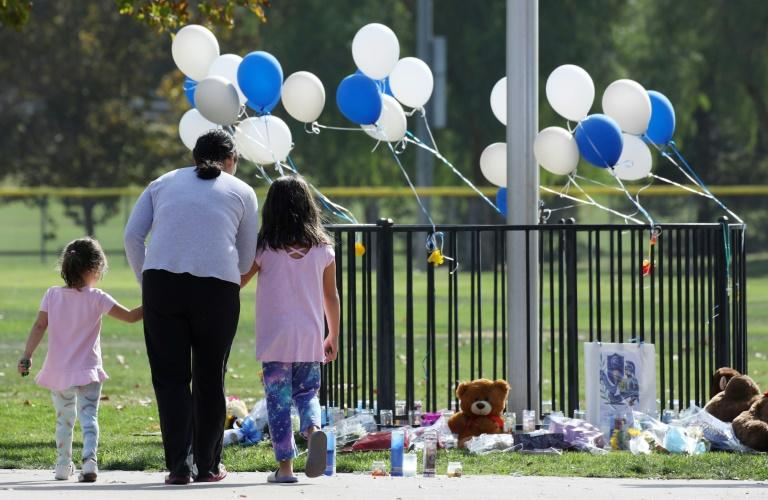 Two of the shooting victims, a 15-year-old girl and a 14-year-old boy, died from their wounds (AFP Photo/MARIO TAMA)