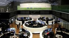 Global stocks jump on Fed stimulus, oil pulls back from earlier surge