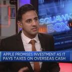 Apple promises investment as it pays taxes on overseas ca...