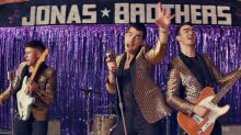 Jonas Brothers hilariously woo their wives in new 'What A Man Gotta Do' music video