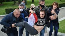 Belarus accuses Russians, Lukashenko critics of unrest plot