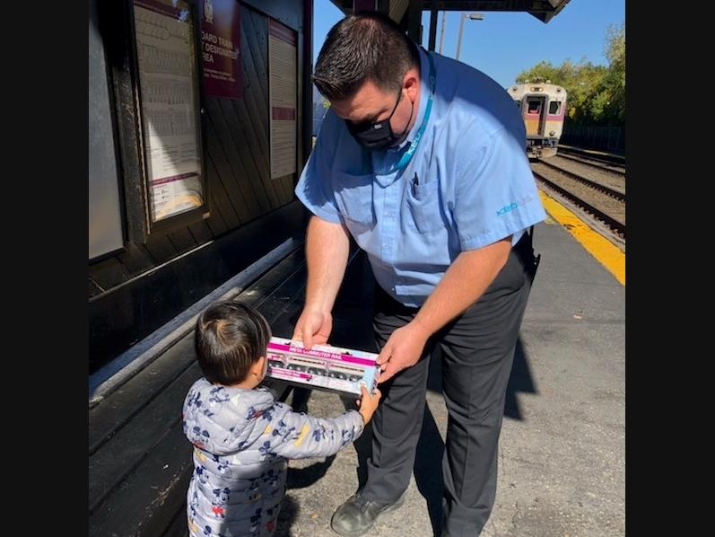 A commuter rail crew made a 3-year-old in Beverly very happy this week with a surprise gift of a toy train set.