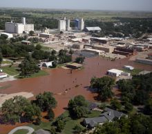 The Latest: Private lake dam in Oklahoma City endangered