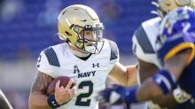 Navy football quarterback competition will continue for another week with South Florida game canceled