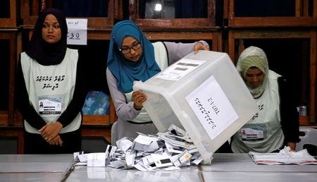 Maldives election commission officials prepare ballot papers for counting votes at a polling station at the end of the presidential election day in Male, Maldives September 23, 2018. REUTERS/Ashwa Faheem