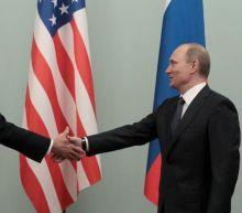Kremlin coy on Putin-Biden summit, warns against U.S. sanctions