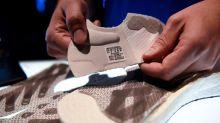 Adidas to close German, U.S. robot factories