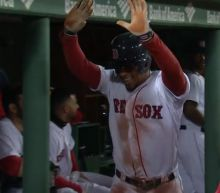 Xander Bogaerts celebrates all by himself after smashing first homer of the year