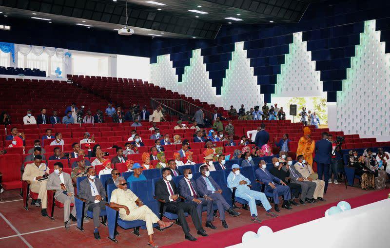 Somalia's President Mohamed Abdullahi Mohamed and government officials sit inside a renovated Somalia's National Theatre in Mogadishu