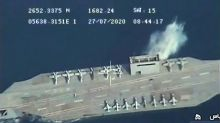 Iran blow up up dummy US aircraft carrier with missiles in Strait of Hormuz