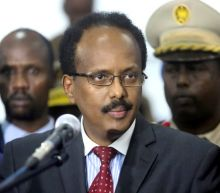 Somalia's president signs law extending his term, 15 killed in attack