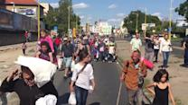 Migrants walk to Austria from Budapest