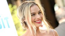 Margot Robbie's Undone Space Buns And Blue Eyeliner Are Spring Beauty Goals