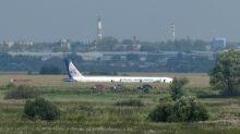 Putin honours 'hero' pilots for Russian corn field landing