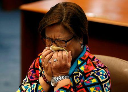 Philippine Senator Leila de Lima reacts before delivering a speech at the Senate in Pasay city, Metro Manila, Philippines September 20, 2016. REUTERS/Erik De Castro