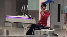 'Well, That's Different': Elton John Impersonator Glides Through Gatwick Airport