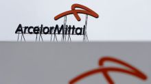 ArcelorMittal forecast of steel pick-up, debt drop lifts shares