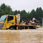 Digger trucks drafted in to rescue people stranded in China floods