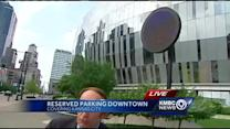 City explores idea of reserving parking spaces