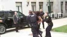 Topless Protester Arrested Outside Bill Cosby Retrial
