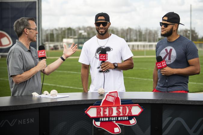 FT. MYERS, FL - FEBRUARY 15: Xander Bogaerts #2 and Eduardo Rodriguez #57 of the Boston Red Sox join NESN anchor Tom Caron on set during a team workout on February 15, 2020 at jetBlue Park at Fenway South in Fort Myers, Florida. (Photo by Billie Weiss/Boston Red Sox/Getty Images)