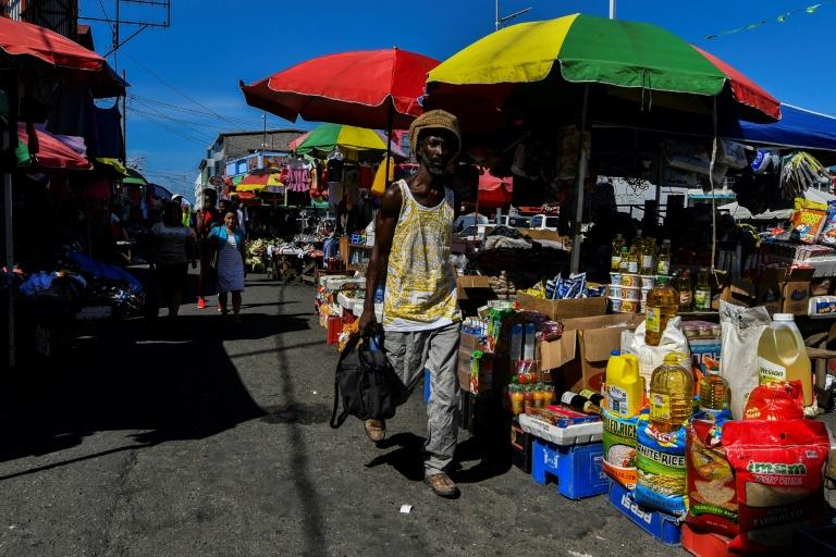 People walk in March 2020 through Stabroek Market in Georgetown, Guyana, which is expected to see rapid economic growth after the discovery of oil