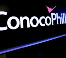 ConocoPhillips forecasts smaller-than-expected loss, to resume buybacks