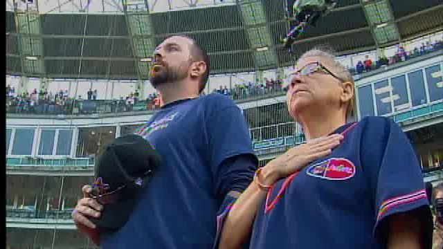 Gina DeJesus's mom throws out first pitch