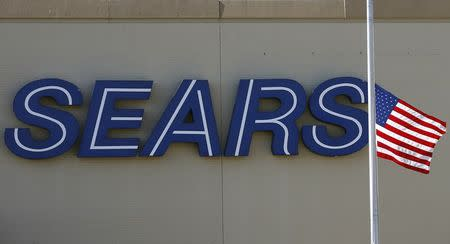 Sears posts $548 million loss, doubles planned 2014 store closures