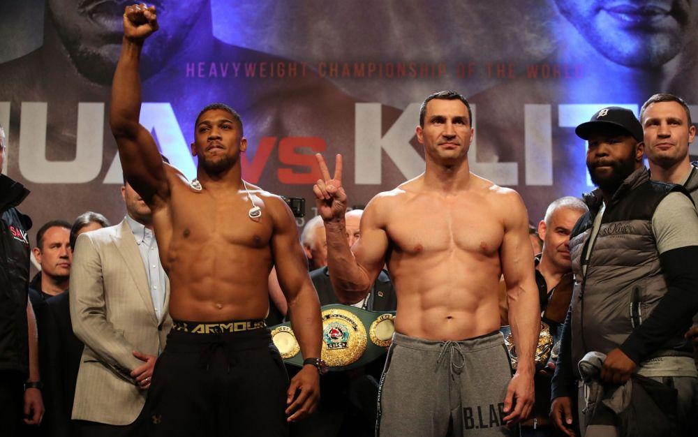Anthony Joshua (L) and Wladimir Klitschko faced off on Friday - PA