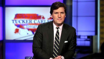 Tucker Carlson profanely berates caller