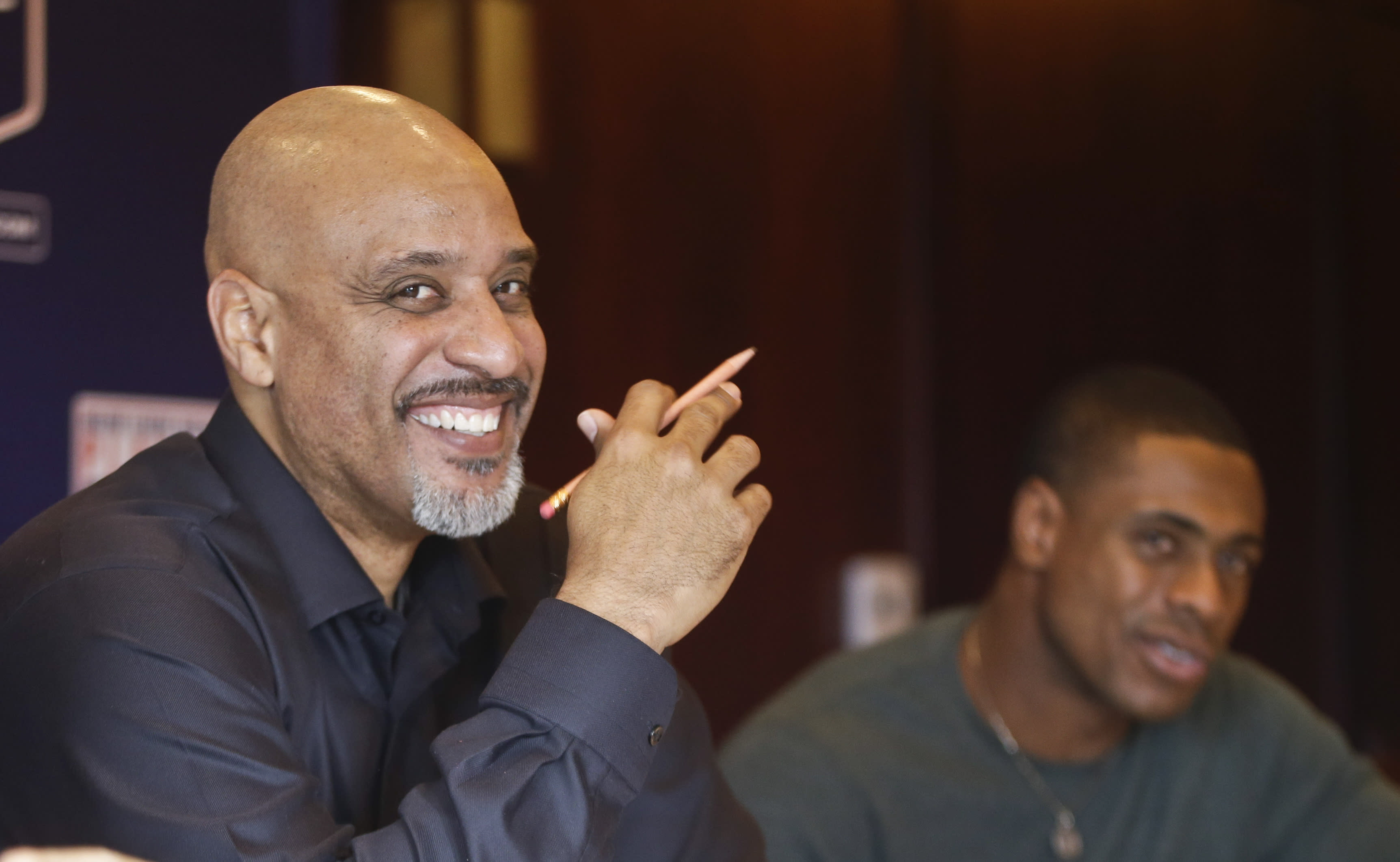 Tony Clark, left, the newly named Executive Director of the Major League Baseball Players Association, finds humor in a question during a news conference at the organizations' annual meeting Tuesday, Dec. 3, 2013, in San Diego. Clark, who replaced the late Michael Weiner, is flanked by executive board member Curtis Granderson. (AP Photo/Lenny Ignelzi)