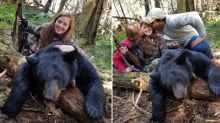 Smiling girl armed with gun poses next to carcass after 'harvesting' bear