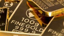 Spot gold prices fall over 4% since one-year high
