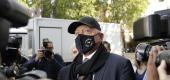 Boris Becker walks through a group of media. (AP)