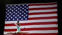 Simone Biles scoops gymnastic win wearing teal leotard in solidarity of sexual abuse victims
