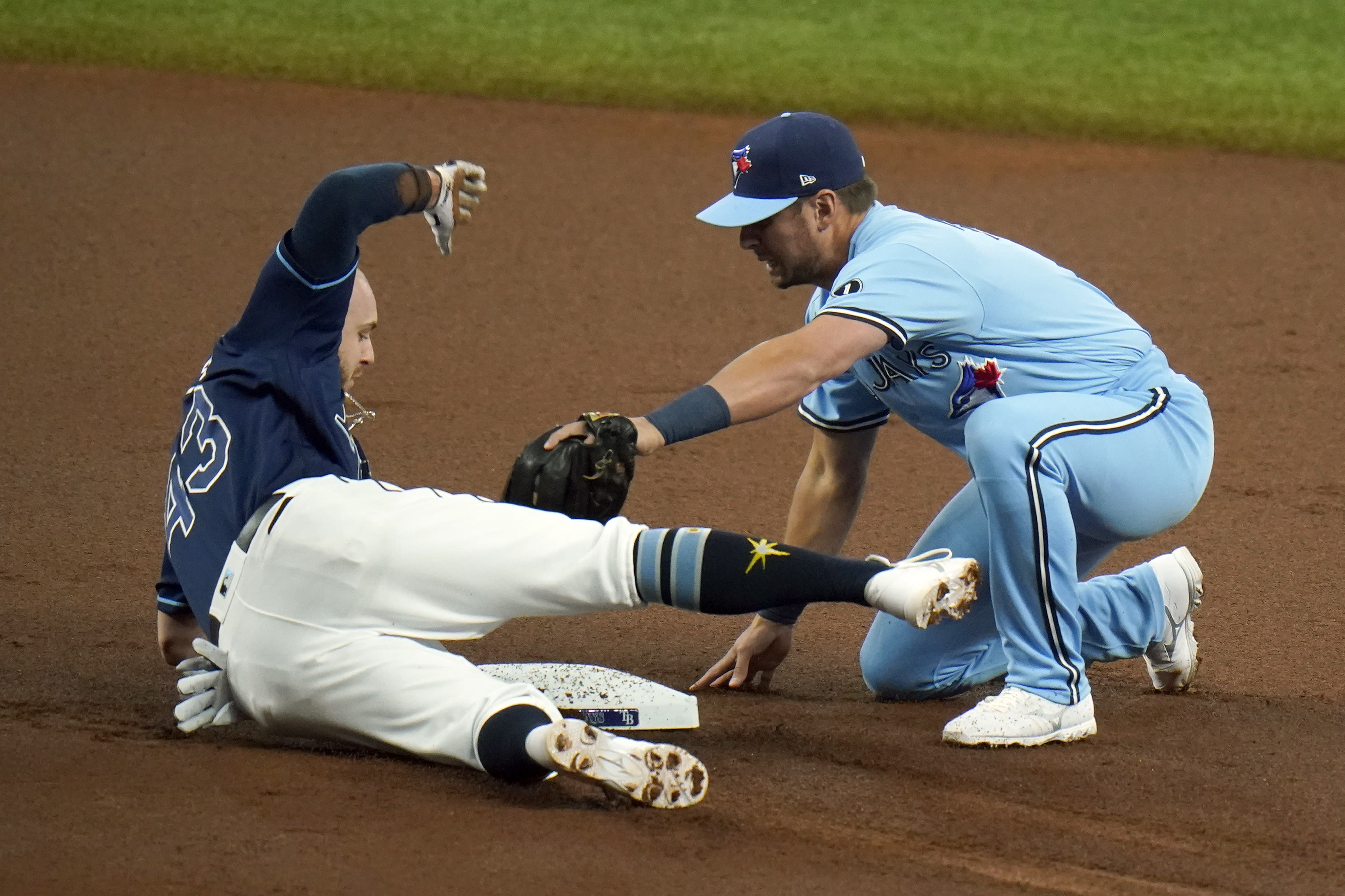 Toronto Blue Jays second baseman Joe Panik tags out Tampa Bay Rays' Michael Brosseau (43) at second base after Brosseau was caught trying to stretch a single into a double during the first inning of Game 2 of an American League wild-card baseball series Wednesday, Sept. 30, 2020, in St. Petersburg, Fla. (AP Photo/Chris O'Meara)