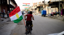 Iraq's Kurds continue retreat, pulling out of Sinjar without a fight while Shiite militias move in