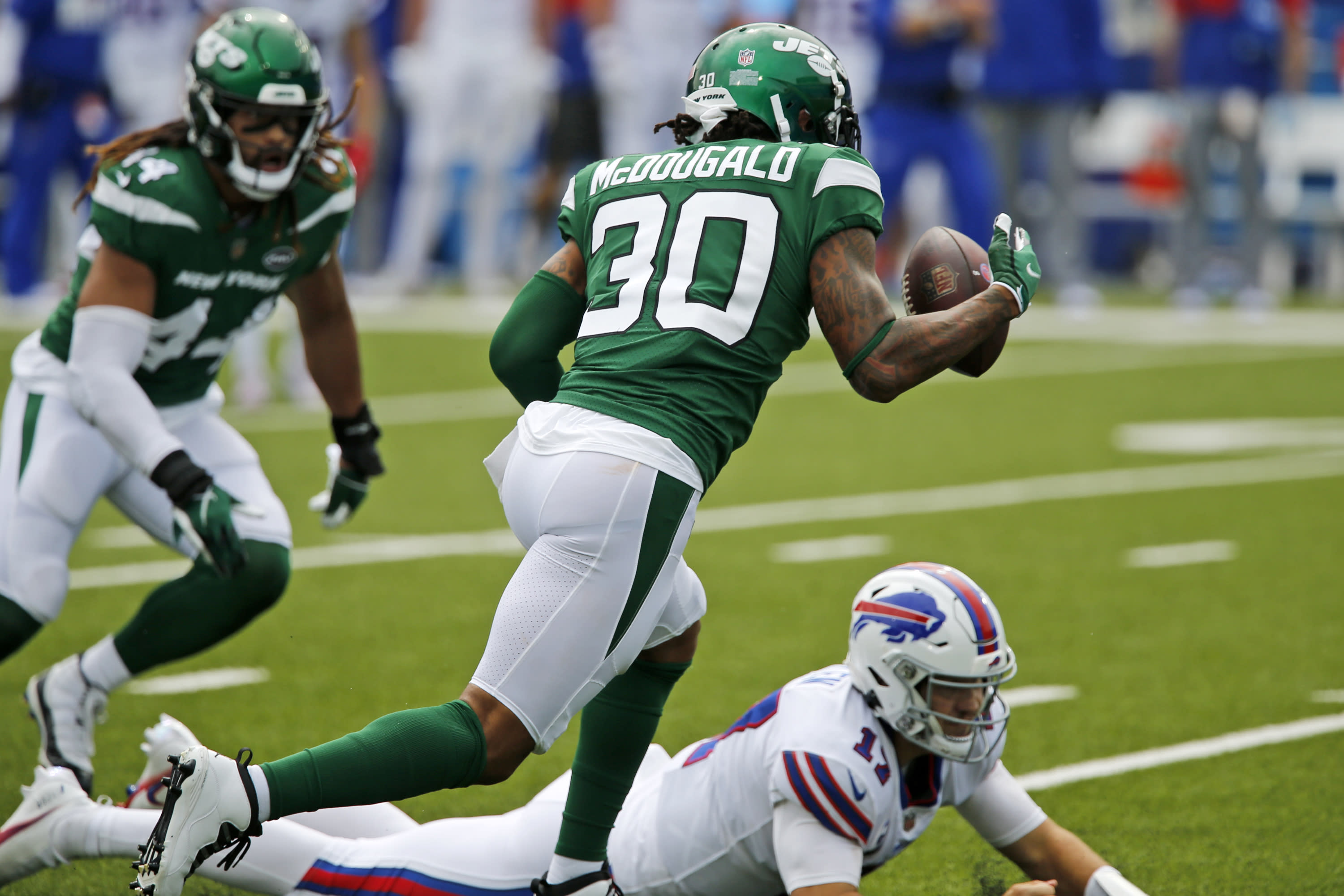 New York Jets strong safety Bradley McDougald (30) recovers a fumble by Buffalo Bills quarterback Josh Allen (17) during the first half of an NFL football game in Orchard Park, N.Y., Sunday, Sept. 13, 2020. (AP Photo/John Munson)