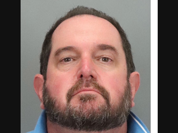 """Alan Viarengo, a 55-year-old Gavilan College math teacher, allegedly fired off a barrage of threatening letters to Santa Clara County Health Officer Sara Cody containing language and symbols authorities say are associated with the """"boogaloo"""" movement."""