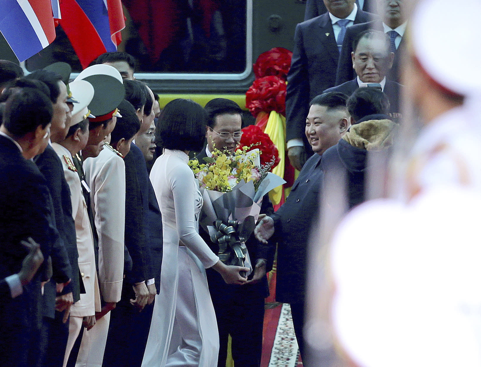 North Korean leader Kim Jong Un, center right, receives a bouquet of flowers upon arrival by train in Dong Dang in Vietnamese border town Tuesday, Feb. 26, 2019, ahead of his second summit with U.S. President Donald Trump. (AP Photo/Minh Hoang)