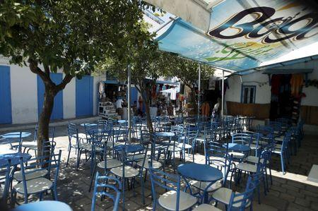 Empty tables are seen at the terrace of a coffee shop in Sidi Bou Said, a popular tourist destination near Tunis