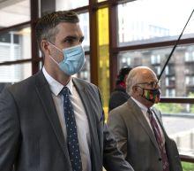 Thomas Lane, former Minneapolis police officer who held George Floyd's legs, seeks dismissal of charges