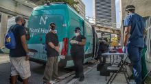 They're taking the COVID vaccine on the road, reaching Miami people who don't have homes