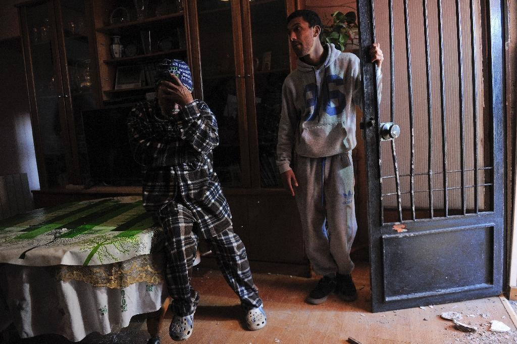 The father and brother Hicham Belkadar (R) of one of four suspects arrested gather in their home in Sant Vicens dels Horts, near Barcelona on February 24, 2015 (AFP Photo/Josep Lago)