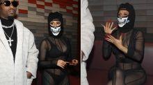 Cardi B wears sheer bodysuit and helmet-style mask at Paris Fashion Week